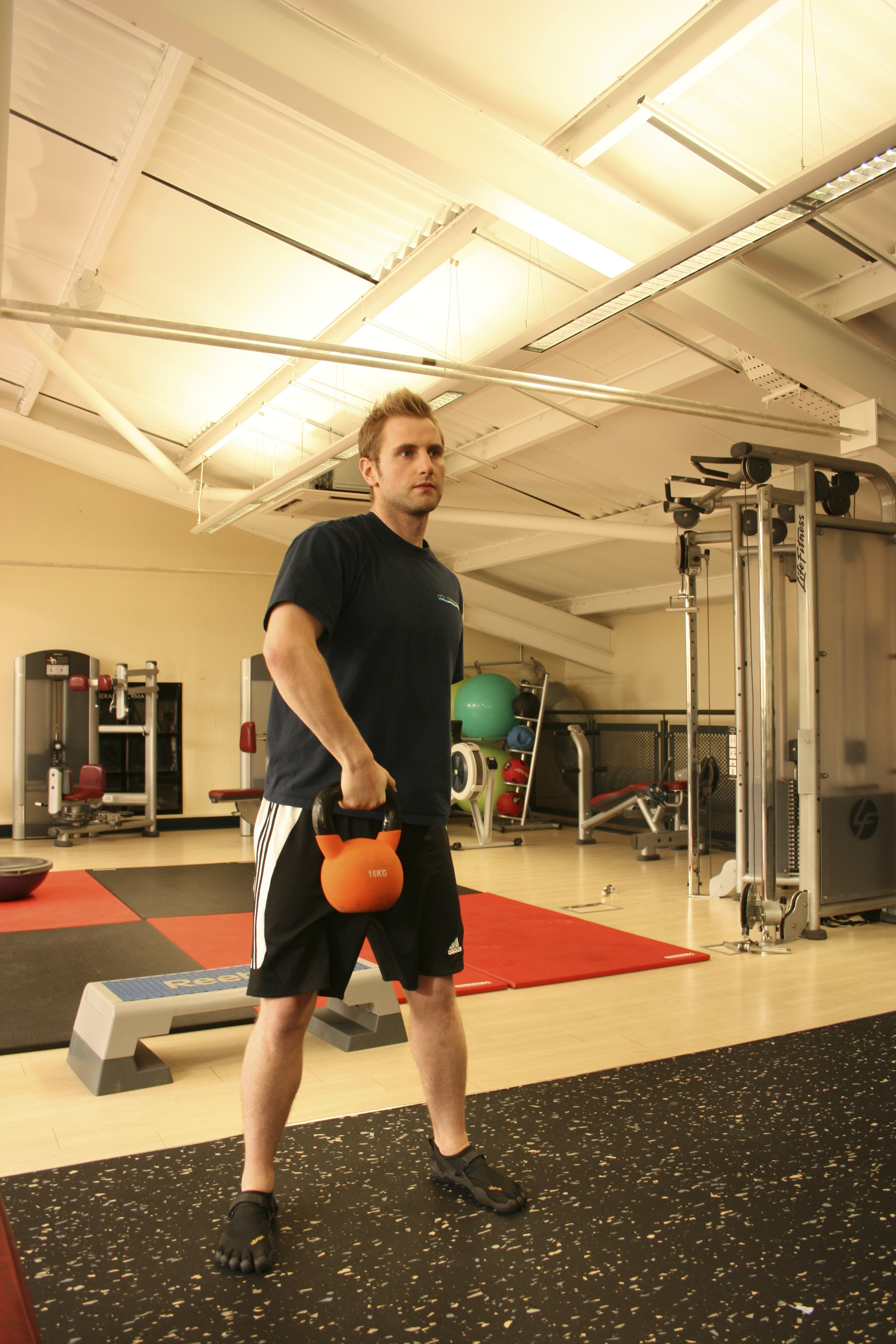Single Arm Overhead Kettlebell Snatch, Uni-Lateral Exercise, Uni-Lateral Training